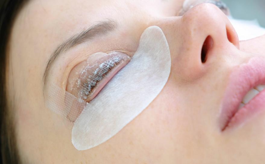 Beauty treatment. lash lamination. Closeup face and eyes.